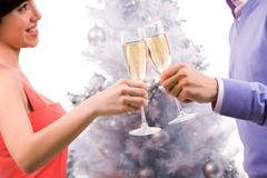 Close-up of couple cheering up with champagne flutes Stock Photos