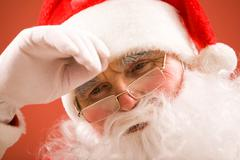 photo of tired santa claus over white background - stock photo