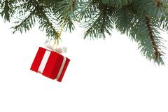 Image of small red giftbox hanging on spruce branch over white background Stock Photos