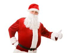 Photo of happy santa claus showing thumb up Stock Photos