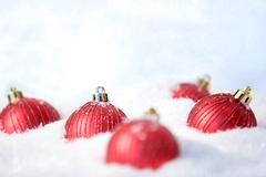Image of red decorative toy balls in the snow Stock Photos