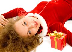 Photo of pretty smiling girl lying with small giftbox near by Stock Photos
