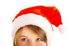 Face of young pretty woman with santa claus hat on Stock Photos