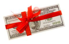 Photo of pack of dollars decorated with red ribbon over white background Stock Photos
