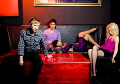 portrait of group of young people relaxing in night club - stock photo