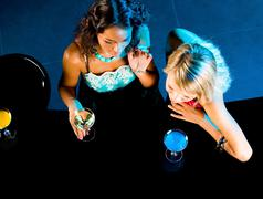 Above angle of glamorous girls in the bar Stock Photos