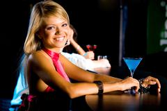 portrait of happy girl looking at camera in the bar - stock photo