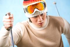 Portrait of healthy sportsman skiing on resort Stock Photos