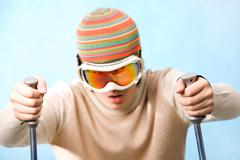 portrait of healthy sportsman in goggles skiing on resort - stock photo