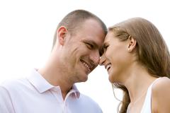 Close-up of happy couple laughing while touching by noses Stock Photos