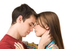 Portrait of amorous dates standing face to face and embracing each other Stock Photos