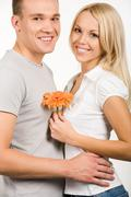 portrait of happy couple looking at camera with smiles - stock photo