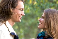 Profiles of romantic couple looking at each other Stock Photos