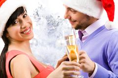 portrait of happy female with champagne flute with her husband near by - stock photo