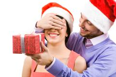 happy man closing female's eyes by his hand - stock photo