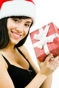 Stock Photo of portrait of pretty woman holding giftbox and smiling to camera