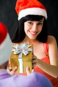 image of happy female giving present at party - stock photo