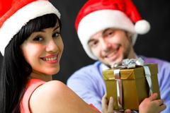 Image of happy female giving present to man Stock Photos