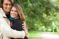 portrait of romantic couple embracing each other - stock photo