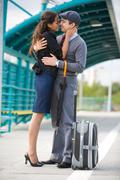 photo of pretty girl and her boyfriend embracing on station - stock photo