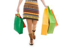 Photo of female going with paperbags in both hands Stock Photos