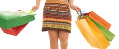 Photo of female wearing brown dress and carrying bags of different colors Stock Photos