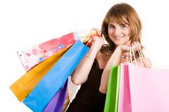 Happy female with bags looking at camera with smile Stock Photos