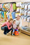 portrait of husband, wife and their cute son in the trade center - stock photo