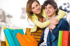 Attractive woman embracing her boyfriend in the mall Stock Photos