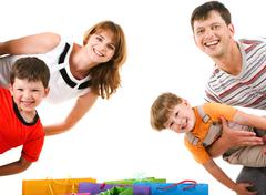 Image of cheerful family members standing looking at camera with happy expressio Stock Photos