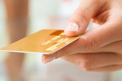 macro image of plastic card in human hand - stock photo