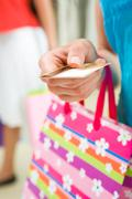 image of woman's hand giving plastic card in the mall - stock photo
