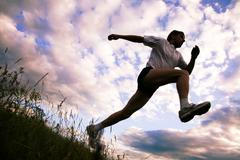 view from below of sportsman doing exercise - stock photo