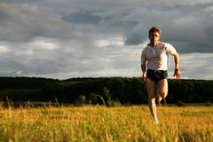 Portrait of strong man running and looking at camera Stock Photos
