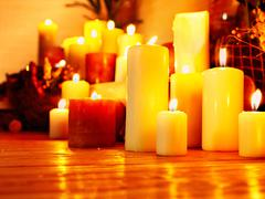 Group lighted candle in spa salon. Stock Photos
