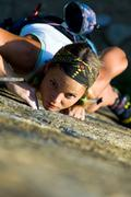 vertical image of girl training rock-climbing - stock photo