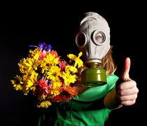 Woman with gas mask and flower. Stock Photos