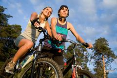 Stock Photo of photo of cyclists on their bikes in park or forest during summer vacations