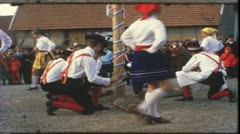 Vintage 8 mm film: Rural funfair, dancing around maypole, Germany, 1960s - stock footage