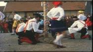 Vintage 8 mm film: Rural funfair, dancing around maypole, Germany, 1960s Stock Footage