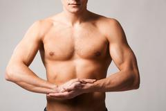 Image of shirtless man keeping his arms by chest Stock Photos