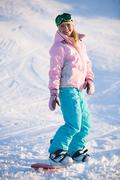 image of happy girl on winter resort snowboarding there - stock photo