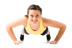 Stock Photo of image of young attractive woman doing physical exercise