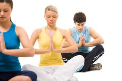 Photo of meditating group sitting with their hands kept in touch Stock Photos