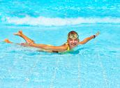 Stock Photo of child in swimming pool.
