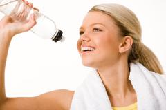 image of beautiful woman going to drink some water from plastic bottle - stock photo