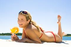 image of smiling woman having rest on beach and enjoying summer - stock photo