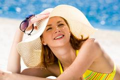 Photo of resting woman in hat holding sunglasses and sunbathing Stock Photos