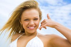 Portrait of beautiful blonde on background of cloudy sky Stock Photos
