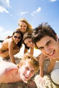 photo of friendly teenagers looking at camera with smiles during summer vacation - stock photo